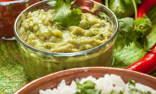 traditional mexican food: cilantro and lime rice, chicken fajitas, fajita peppers, burritos, tortillas, guacamole and salsa